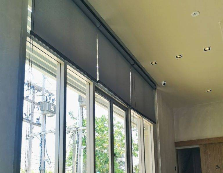 commercial dark grey roller blinds in office