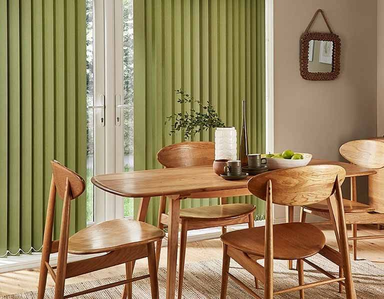 green vertical blinds in a dining room